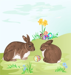 Easter rabbits and easter eggs in the grass vector