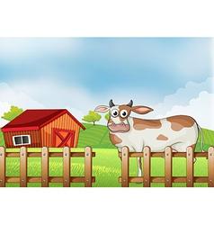 A farm with a cow vector image vector image