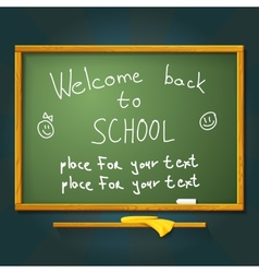 School desk with chalk welcome back message and vector image