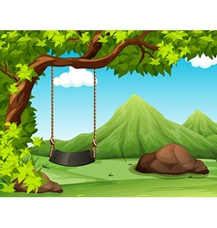 Nature scene with swing on the tree vector image