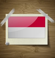 Flags indonesia at frame on wooden texture vector