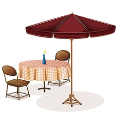 A table with an umbrella in a cafe vector