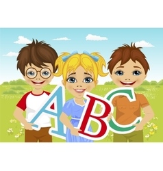 Kids holding the abc letters in flower field vector
