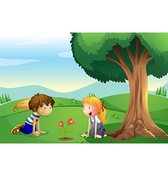 A girl and a boy watching the plant grow vector