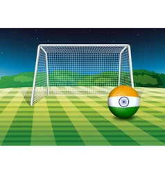 A soccer ball near the net with the flag of india vector