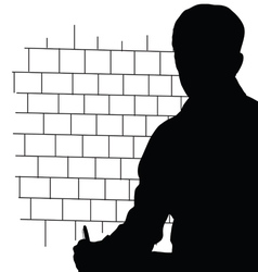 Man front brick wall silhouette vector