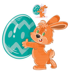 easter bunny holding a decorated egg in its vector image