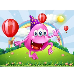 A happy pink beanie monster jumping at the hilltop vector image