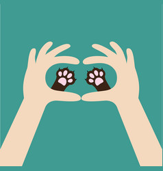 Two hands holding cute cat dog paw print love and vector