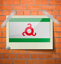 Flags ingushetia scotch taped to a red brick wall vector