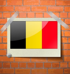Flags belgium scotch taped to a red brick wall vector