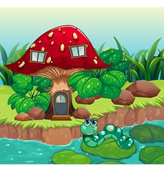 A worm near the red mushroom house vector image
