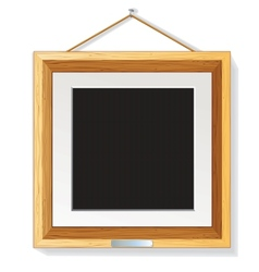 Wooden photo frame on the wall vector