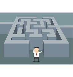 Businessman at the starting point of a maze vector
