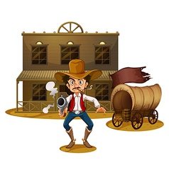 An armed man near the wagon vector image vector image