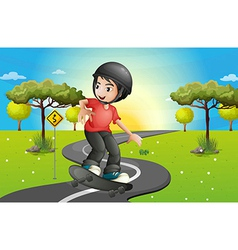 A boy skateboarding at the road vector image
