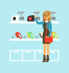 Young blond woman choosing a meat grinder in home vector