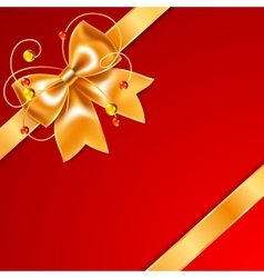 Golden bow of silk ribbon isolated on red vector