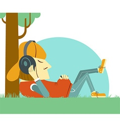 Young boy listening to music on nature green grass vector