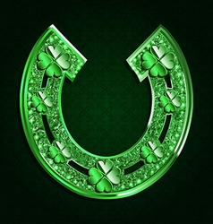 Green horseshoe on a dark background vector