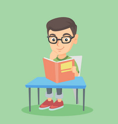 student sitting at the table and reading a book vector image