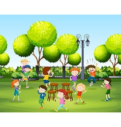 Children playing music chair in the park vector