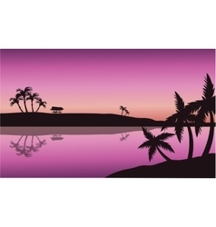 Silhouette of palm in seashore vector