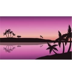 Silhouette of palm in seashore vector