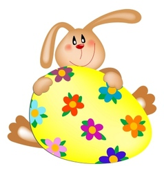 Easter bunny with a painted egg vector image vector image
