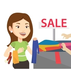 Young woman choosing clothes in shop on sale vector