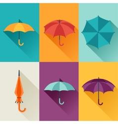 Set of cute multicolor umbrellas in flat design vector
