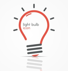 Light bulb icon with rays vector