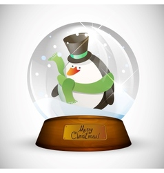 Christmas snow globe with penguin vector