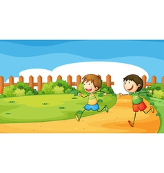 Two boys playing inside the wooden fence vector