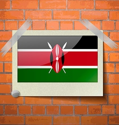 Flags kenya scotch taped to a red brick wall vector