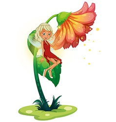 A fairy floating near the giant flower vector image vector image