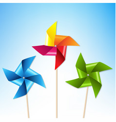Colorful pinwheels with blue sky vector