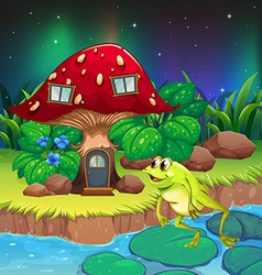 A frog jumping near the red mushroom house vector image