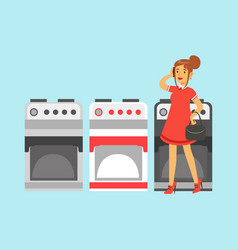 Young woman choosing an electric stove in home vector