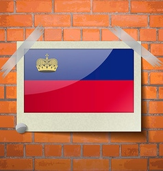 Flags liechtenstein scotch taped to a red brick vector