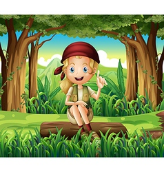 A forest with a young girl sitting above a log vector image
