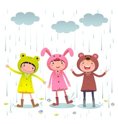 Kids wearing colorful raincoats and boots playing vector