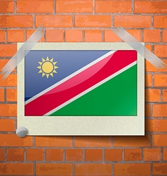 Flags namibia scotch taped to a red brick wall vector