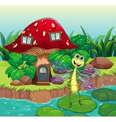 A giant mushroom house with a dragonfly vector