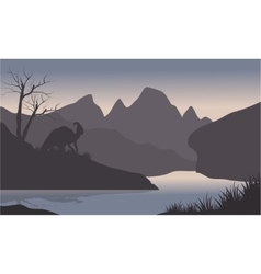 Silhouette of parasaurolophus in riverbank vector image