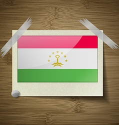 Flags tajikistan at frame on wooden texture vector