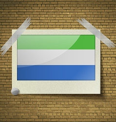 Flags sierra leoneat frame on a brick background vector