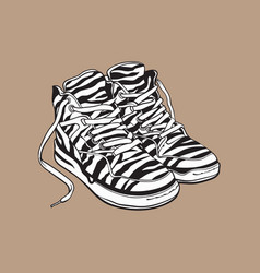 pair of zebra patterned sneakers sport shoes from vector image