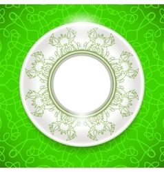Ceramic ornamental plate on green background vector