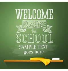 Welcome back to school message on the chalkboard vector